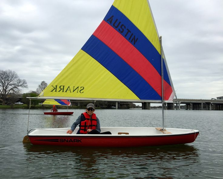Snark dinghy sailboat.  Beginners learning how to sail.