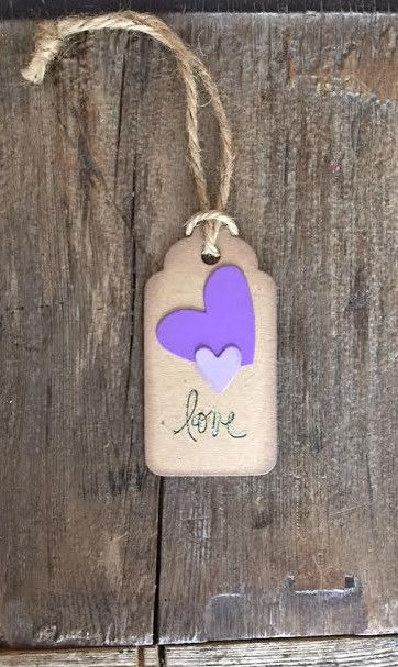 """Love!"" Gift Tag These gorgeous handmade tags are a great way to show your support and excitement for your friend/wife/partner/co-worker's approaching baby! Each one will be placed on the neck of the"
