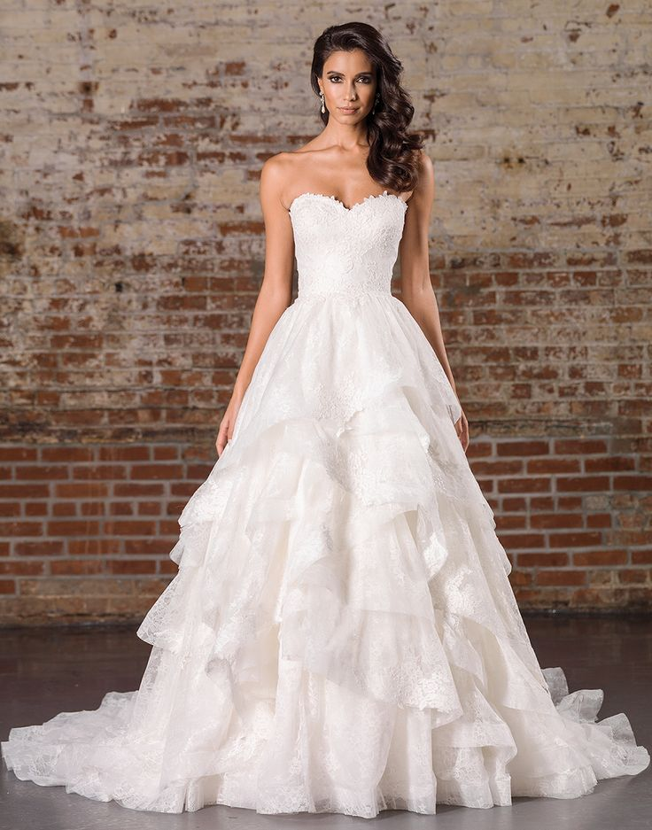 Justin Alexander signature wedding dresses style 9859 Ivory Size 10A voluminous ball gown skirt meets soft styling in this gown with a sweetheart neckline, natural waistline, allover lace details, and a tiered skirt.