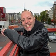 Muscian Lotto King Karl beams out a smile as he arrives in Hamburg
