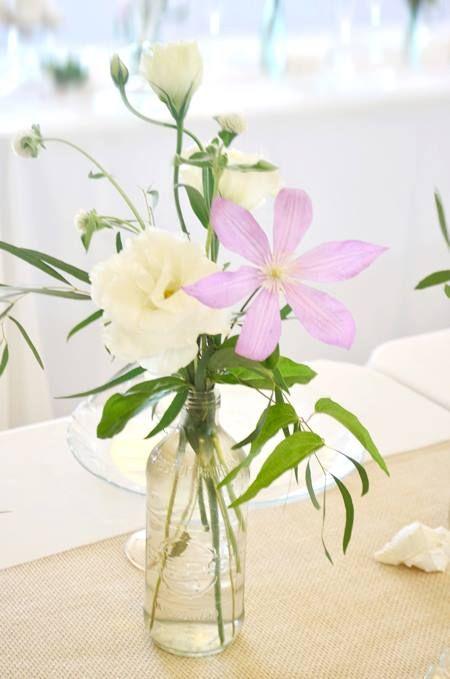 White and purple flowers in a vintage bottle | by Gavita Flora | www.gavitaflora.com #wedding #flowers