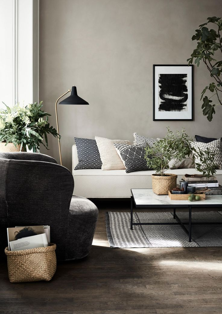 Lovely shot by H&M Home.   The Natural Wood Floor Company thinks...The mid-tone brown wooden flooring works well with the light walls and sofa.  The plants bring the space to life.