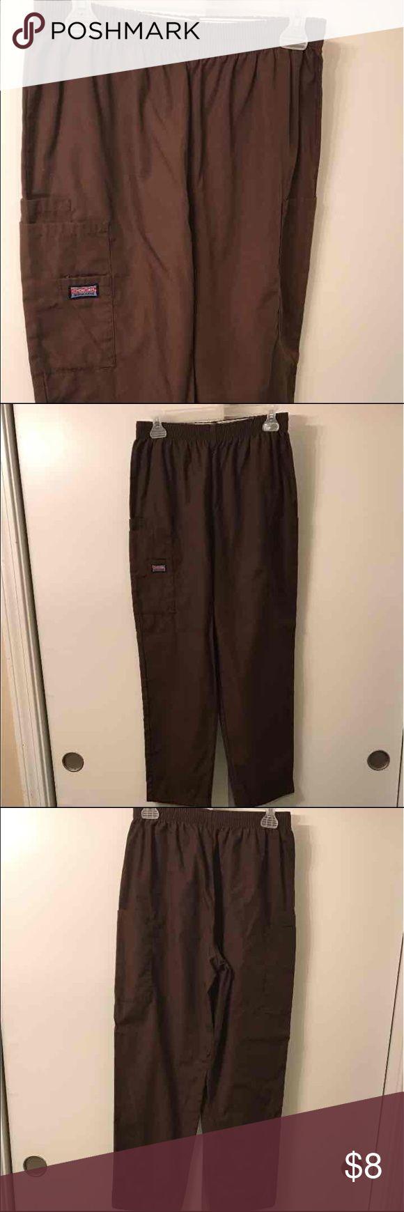 Cherokee Scrub Pants Brand new! Size small, brown Cherokee brand scrub pants. Cargo style pants with pockets on both pant legs, elastic waistband Cherokee Pants