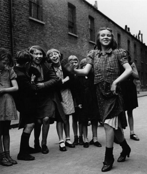 East end girl, dancing the Lambeth Walk , 1939   by Bill BRANDT
