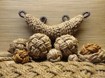 """This is a variety of fancy knots done in 1/4"""" and 3/8"""" manila rope.  There are monkey's fists, globe knots, rope mats, Turk's Heads and a Bow fender, or Dolphin fender, for a dinghy."""