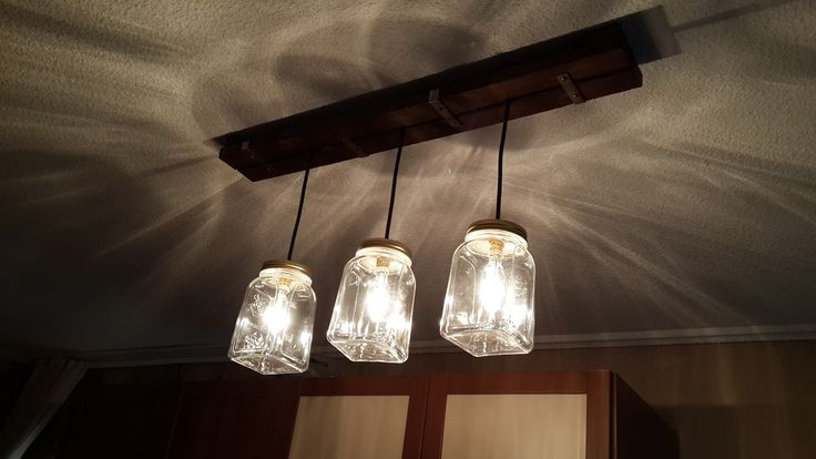 Vintage style lighting with 3 jars and wood