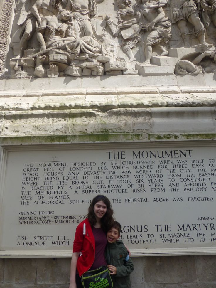 Outside the Monument to the Great Fire of London, as seen on the Family Travel Times blo