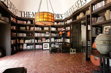 Diane Keaton's library (add a round table & it'a a great entry/dining space w/ cabinets at bottom shelves for dishes)