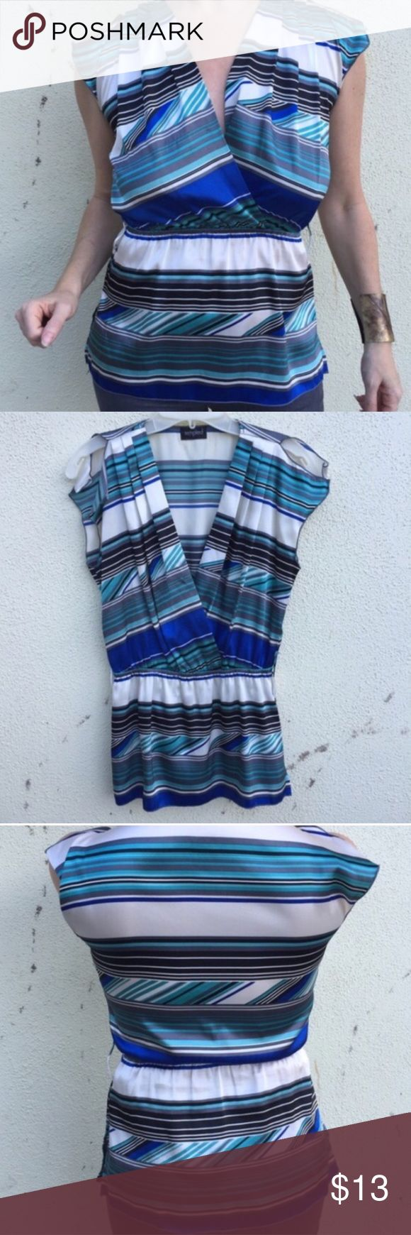 SALE‼️Blue white striped TOP blouse peplum wrap M Satiny top with stripes, faux wrap neck and elastic waist creating almost a peplum silhouette. Great with straight skirts! Polyester. Fits medium. Tag removed. (N15) Guess Tops Blouses