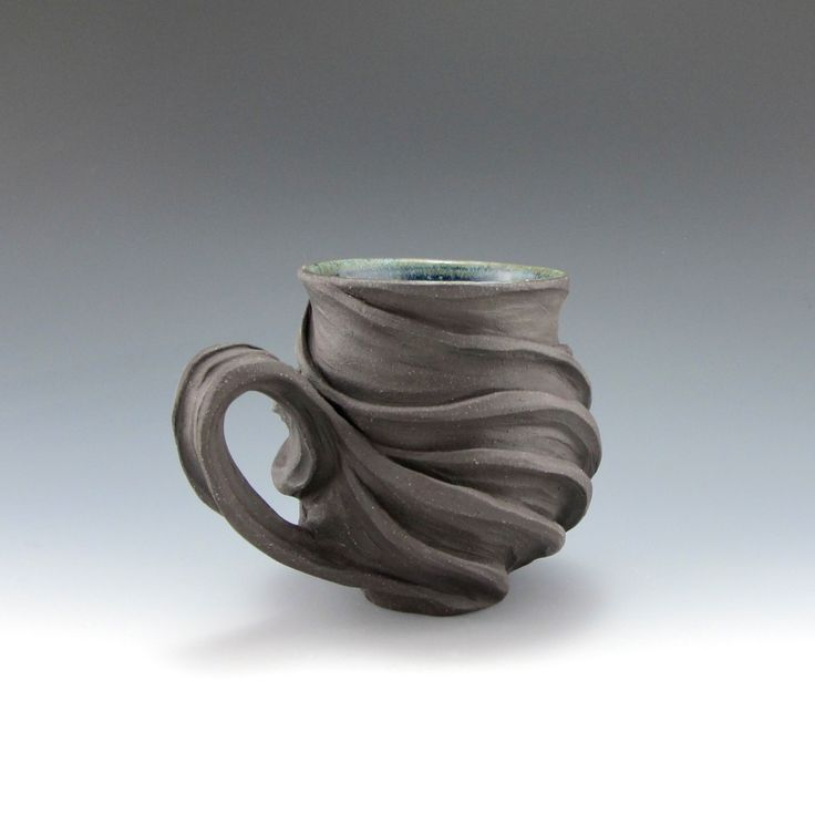 stoneware mug- I love the handle and how it relates to the form