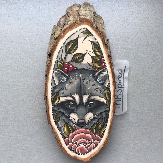 Wood slice with an original drawing of a raccoon door Inkspirednl