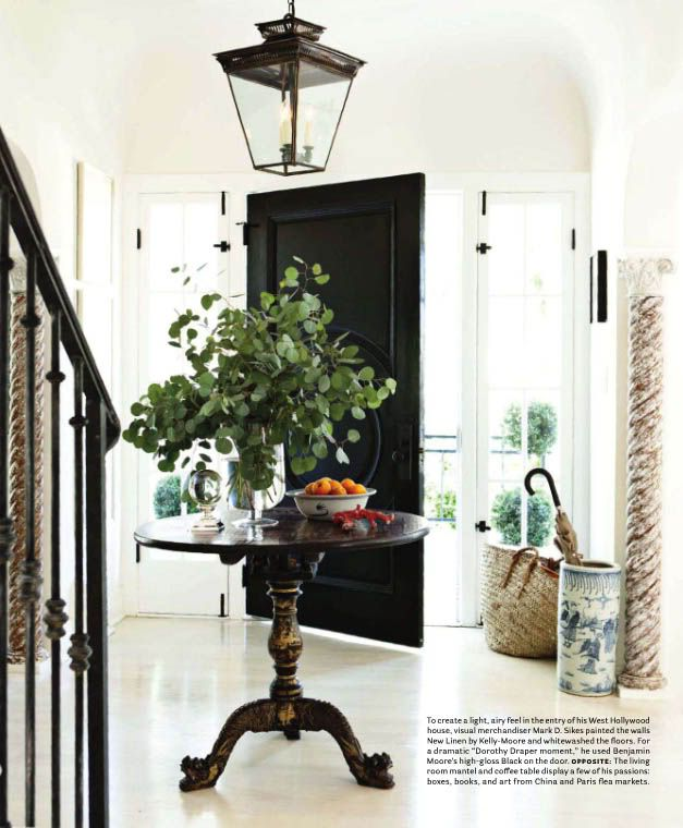 black door, side transoms, lantern, metal stair spindles, table (Marcus Design)