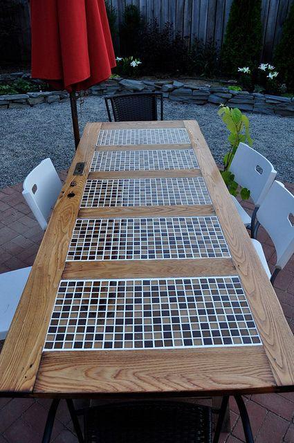 Outdoor table: old door & tiles. @Marielle de Geest de Geest Deighan, would this fit in your new backyard decor?