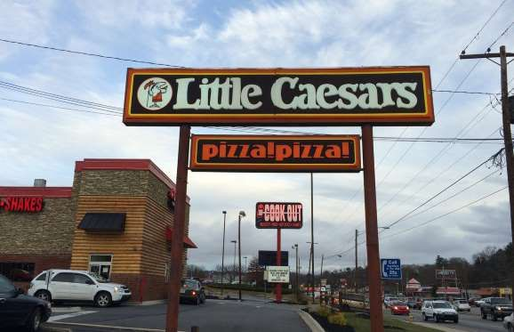 """Little Caesars"" pizza, which was founded in 1959 in the Detroit suburbs, is perhaps best known for its mascot's catch- phrase ""Pizza, Pizza!"" as phrase originally intended to advertise a deal where 2-pizzas were served for the price of one of their competitor's pie."