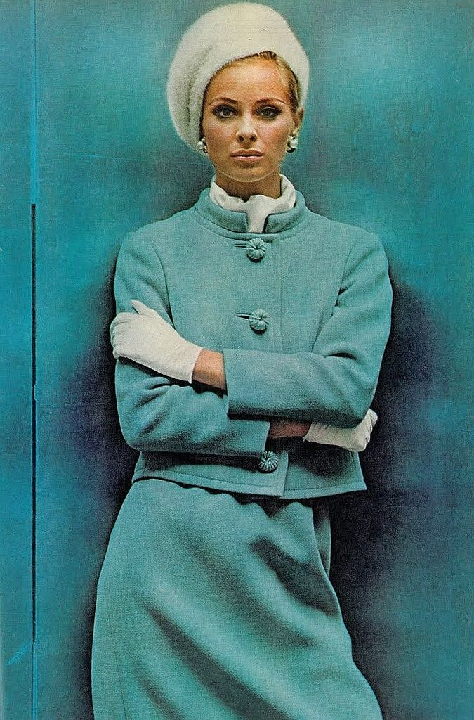 Camilla Sparv in a pale blue wool suit with mandarin collar and braid buttons by Seymour Fox, photo by Helmut Newton for Vogue, 1965.