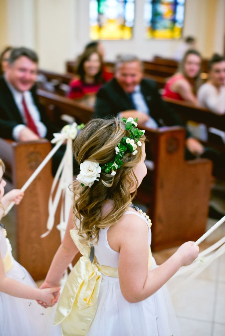 waving magical flower wands, sweet little flower girls hold hands down the aisle making way for the bride's grand entrance. flower crowns made of white spray roses, button chamomile, and white bacopa.