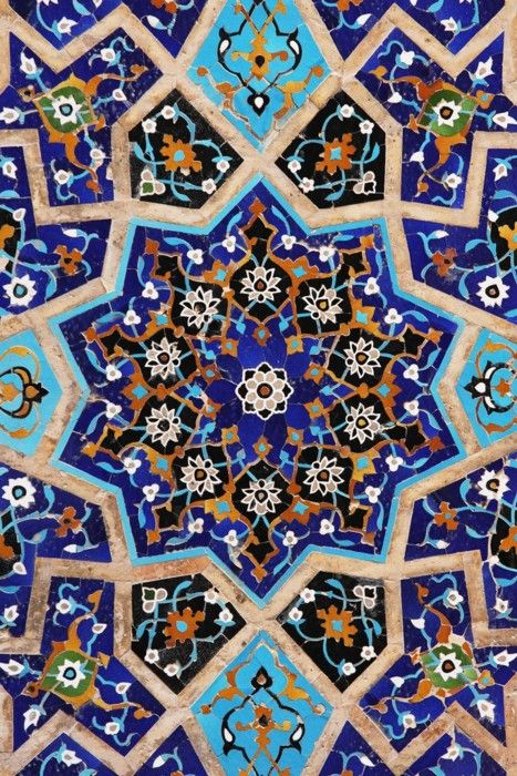 Mosaic tile. Blues, oranges and gold.