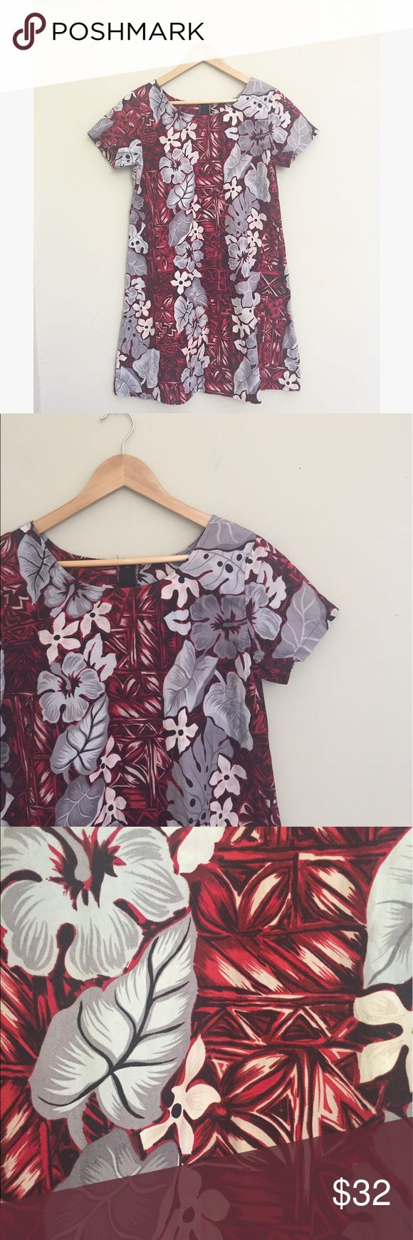"Hawaiian Hibiscus Aloha Floral T Shirt Dress Red cotton T shirt dress with silver Hibiscus and Leaf Print. Back zip, 34"" long, 20"" pit to pit. No size, measured to a M/L. No trades, offers welcome! Hawaiian Flavor Dresses"