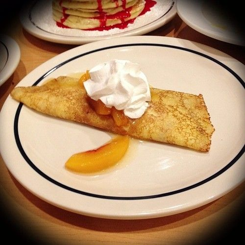 {IHOP's Peach Sweet Cream Cheese Crepe}: a soft delicate crepe filled with lightly sweetened cream cheese and topped with a bounty of premium peaches, finished with a fluffy whipped topping - taking peaches and cream over the top!