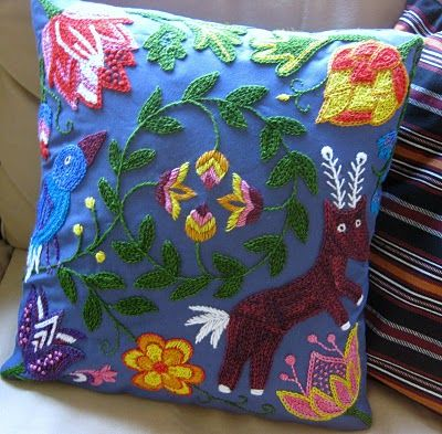 Karin Holmberg...love her stuff, specially her embroidered hoodie jacket! This cushion is lovely.