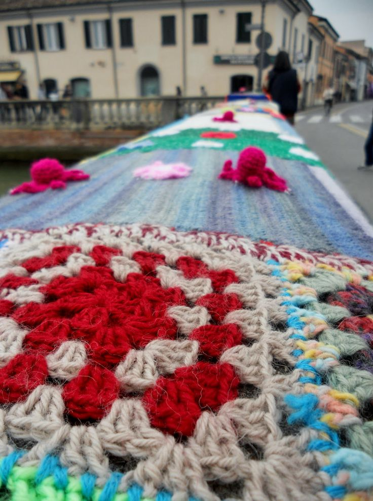 The 'Bridge Garibaldi' in the centre of Italian town of Cesenatico covered by coloured knitting!!   It took 40 kg of wool thread and 70 women from 'Centro Donna' to create 'The Sea of Wool'.