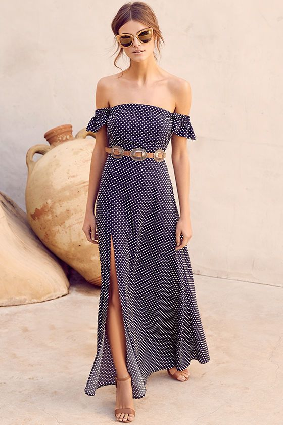 The Dream Love Navy Blue Polka Dot Off-the-Shoulder Maxi Dress has captured our hearts! Lightweight, woven cream and navy blue polka dot fabric is formed to a darling, off-the-shoulder neckline with fluttering short sleeves, and elastic for fit. More elastic trims the high waist atop the maxi skirt with side slit. Hidden side zipper. Belt not included.