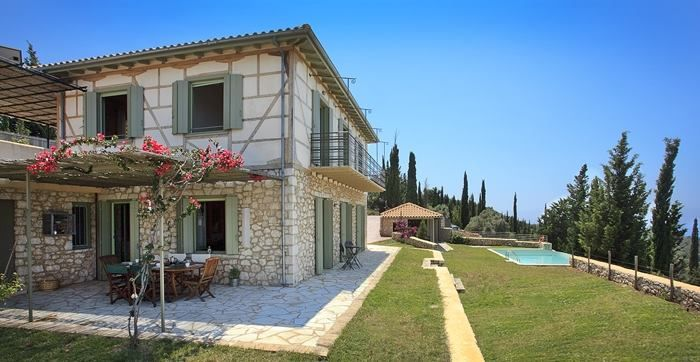 The beautiful garden of the traditional villa melivaro