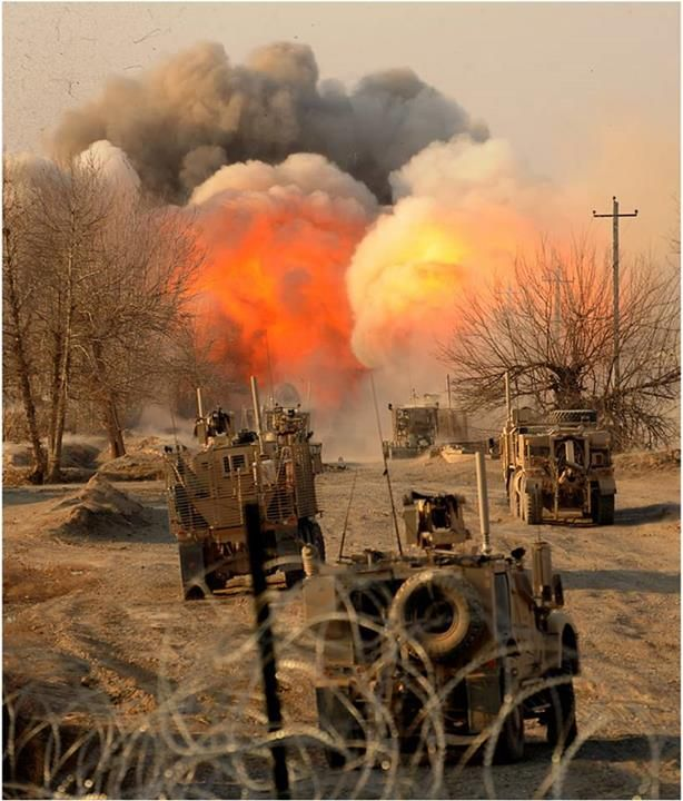As a concussion rocks the ground a ball of smoke and flame and debris erupts into the air after a mine-clearing line charge detonates as Army combat engineers clear a section of road in the Gor Tepa region of the northern Afghanistan province of Kunduz. Photo by Sgt. 1st Class John Queen