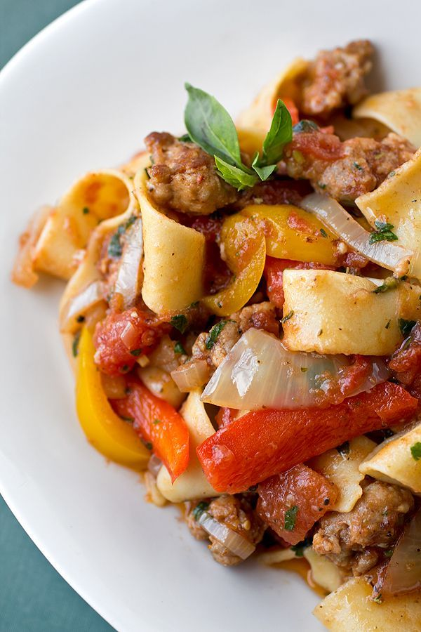 """Saucy Italian """"Drunken"""" Noodles with Spicy Italian Sausage, Tomatoes, Caramelized Onions and Red and Yellow Bell Peppers with Fresh --Try this recipe with your favorite Johnsonville Italian Sausage."""