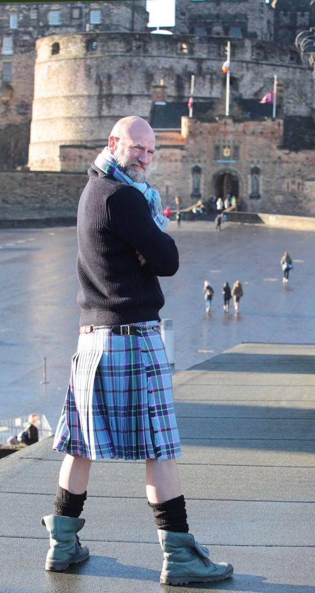 Graham McTavosh wearing the World Peace Tartan outside Edinburgh Castle