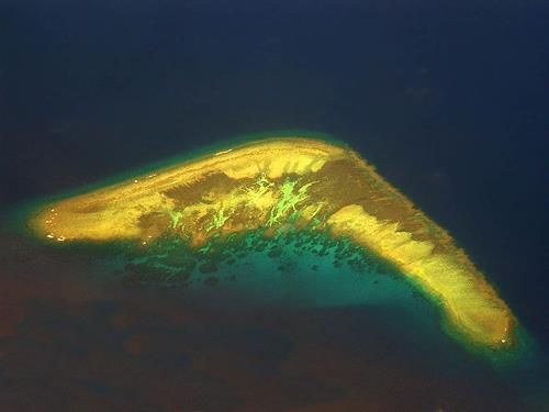 The boomerang shaped island is belonging to the Spratly group. The island or atoll change its shape depending on the season.