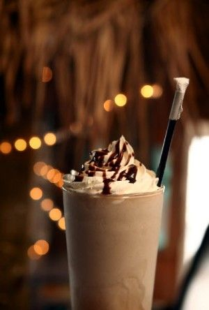 I've had these! Delicious! ☆ Drunken Monkey:  1 ounce Absolut Vanilla,  1 ounce Creme de Cocoa,  1 ounce banana liqueur,  1 ounce Bailey's Irish Cream,  Ice,  Blend all the ingredients well with ice. Lace with chocolate syrup ☆