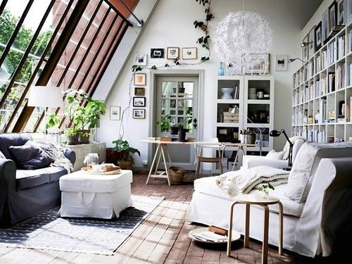 big windows, cozy couches living room