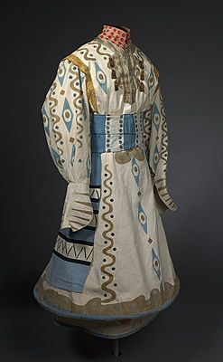 ¤ Aleksandr GOLOVIN  designer Russia 1863 – Russia 1930  France 1887-89, and regular visits thereafter    Paris  France producer 1909 – 1929    Léon BAKST  designer Belarus (Russia) 1866 – France 1924  France from 1912    Costume for an attendant of the Immortal Köstchei 1910  robe: stencilled cotton, metallic brocade ribbon and fringe, lamé, rayon, paint, metal fasteners, skirt hoop; belt: stencilled cotton, rayon, paint, metal fasteners  'Young, Balotine' inscribed on belt ribbon.