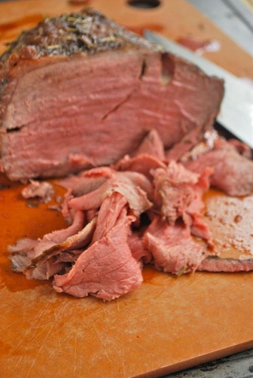 Ingredients: 2½ lbs. boneless rump roast (round roast or sirloin tip will work),  1-2 tbsp. olive oil,  2-3 garlic cloves, sliced,  ½ cup water,  ½ cup beef stock,  1 tsp. kosher salt,  1 tsp. ground black pepper,  1 tsp. dried thyme,  1 tsp. dried basil,  1 tsp. dried tarragon,  1 tsp. dried rosemary.