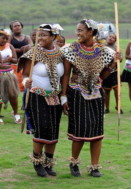 Two Zulu young women Duduzile Zuma, right, and Phumzile Zuma attend their uMemulo (coming of age) ceremony at the Zuma homestead in Nkandla in Kwa-Zulu Natal.