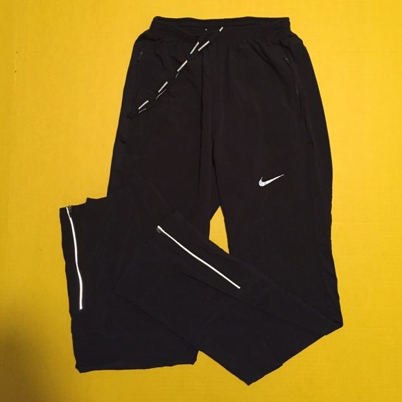 Nike Running pants Women's Nike dri fit running pants, size small, excellent condition with no flaws, worn only a couple of times, full length, straight leg, zippers on ankles, reflective detail, great running pants, bundle to save ❤️ the logo is not cracked or damaged at all(the pics make it look like it is). Nike Pants