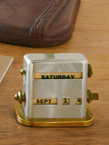 Manufactured by Park Sherman in the late 1940s or early '50s, this aluminum calendar, priced at around $20, keeps up-to-date with a few turns of its brass knobs.