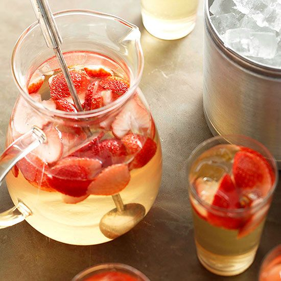 This simple white strawberry sangria only has four ingredients! More strawberry drinks: http://www.bhg.com/recipes/drinks/fruit/strawberry-studded-drinks/?socsrc=bhgpin071313whitestrawberrysangria=8