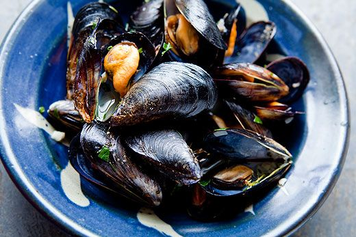 A traditional French dish, mussels mariniere, or moules mariniere. Mussels steamed in white wine, served in sauce of juices from the mussels, wine, butter, and shallots.