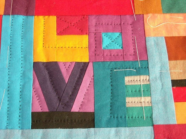 amazing! :) mini word quilt - love the solid quilt and looks like hand quilting