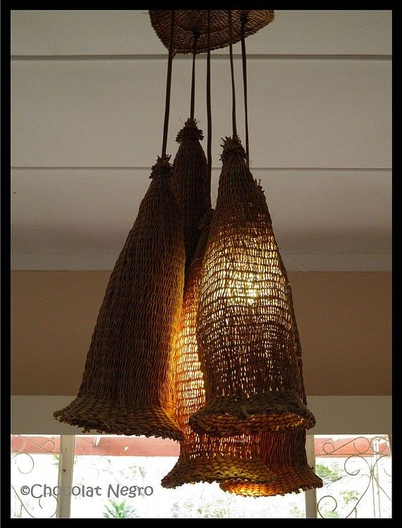 chandelier made from traditional hand-woven beer strainers made of reed grass. the beer strainers are still used in rural areas of South Africa to strain handmade beer