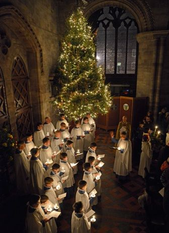 Christmas candlelight service at Hereford Cathedral in England. The Hereford cathedral dates from 1079 and its library has one of the oldest and finest Magna Carta documents in the world. The library also contains the Mappa Mundi,the largest medieval map known to exist.