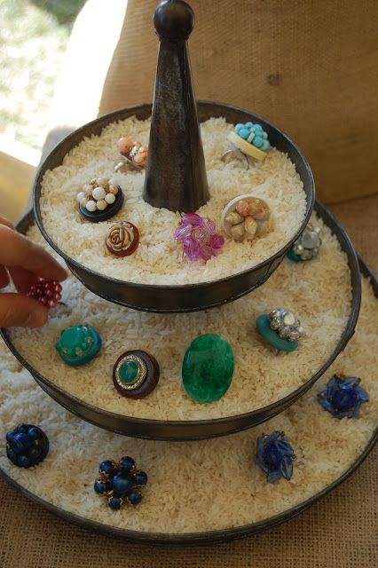 Neat idea for displaying rings. I've been using rice but need to find a tiered bowl like this.