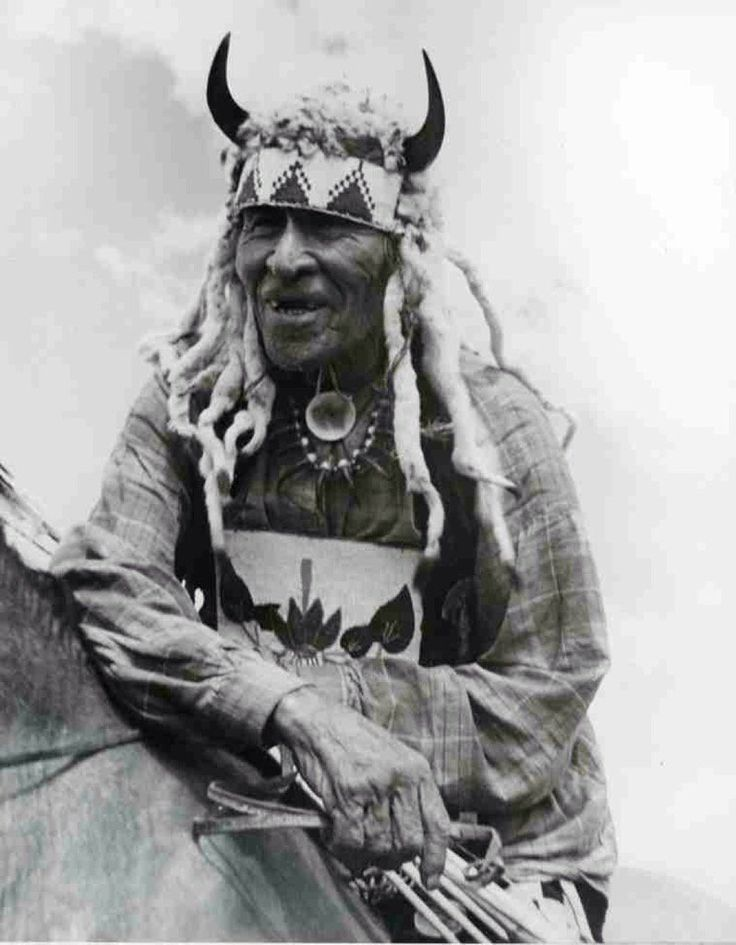 Fine Day' ~ Orator, war chief, with bison horn & weasel headdress' ~ (Plains Cree) 1926  Source: [Sask. Lib. Arch.]