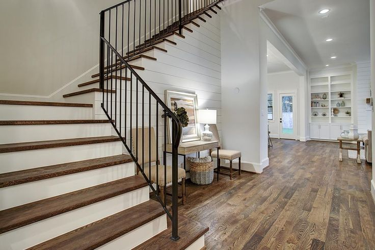 927 42nd St Houston, TX 77018: Photo Solid wrought iron baluster and simplistic spindles are complimented by ship lap detailing, wide plank white oak flooring and solid wood stair treads.