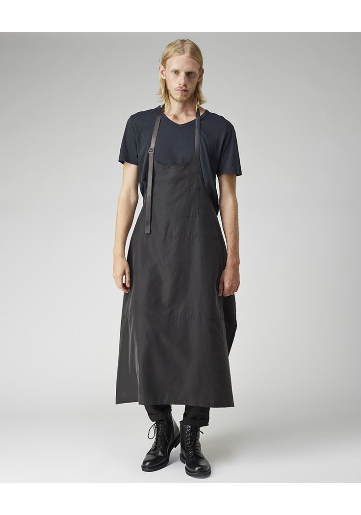 "Apron Dress by Yohji Yamamoto.  Unisex apron-inspired dress with adjustable, tonal leather straps. Model's height is 6'1""; waist 30""; suit 40R; shirt 15"" Worn with / Acne Studios Dublin V-Neck Tee, Comme des Garçons Shirt Man Drop Crotch Pants & Common Projects Combat Boot."