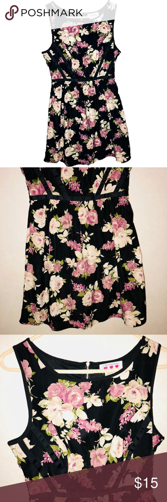 Size 7 Three Pink Hearts Floral Dress Brand: three pink hearts  Size: 7  Details: black with pastel floral rose graphic throughout. Zip up back. Thick strap tank style. Rib ion black detail in torso area and a loose fit bottom kind of like a fit and Flare. Juniors sizing but could fit Women's to.  Condition: Like New  Material: 100% polyester   Feel free to bundle to SAVE! Best offers are welcome! Three Pink Hearts Dresses Mini