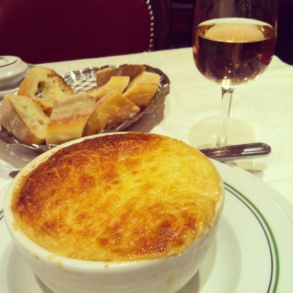 An unforgettable french onion soup with a generous and crusty topping of cheese hiding a piping hot, rich meaty broth with deeply caramelized onions and thick slices of baguette.