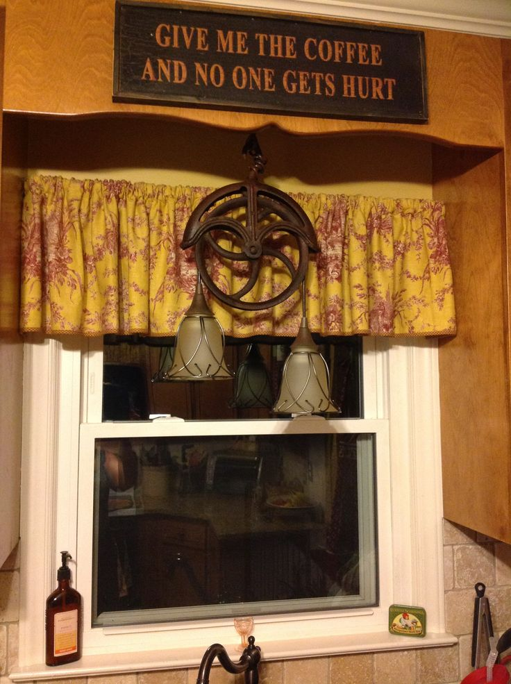 Light fixture made from old well pulley pins that i for Uses for old pulleys